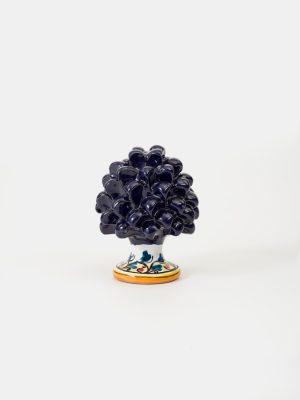 Pigna con piede decorato realizzata a mano da Terrecotte del Sole, colore blu, decoro in giallo arancio con foglie blu.