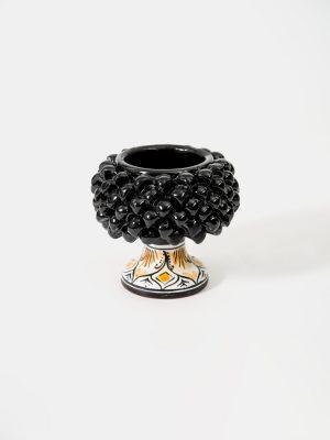 Pigna portapianta realizzata a mano da Terrecotte del Sole, colore nero, decoro floreale nero e arancio.